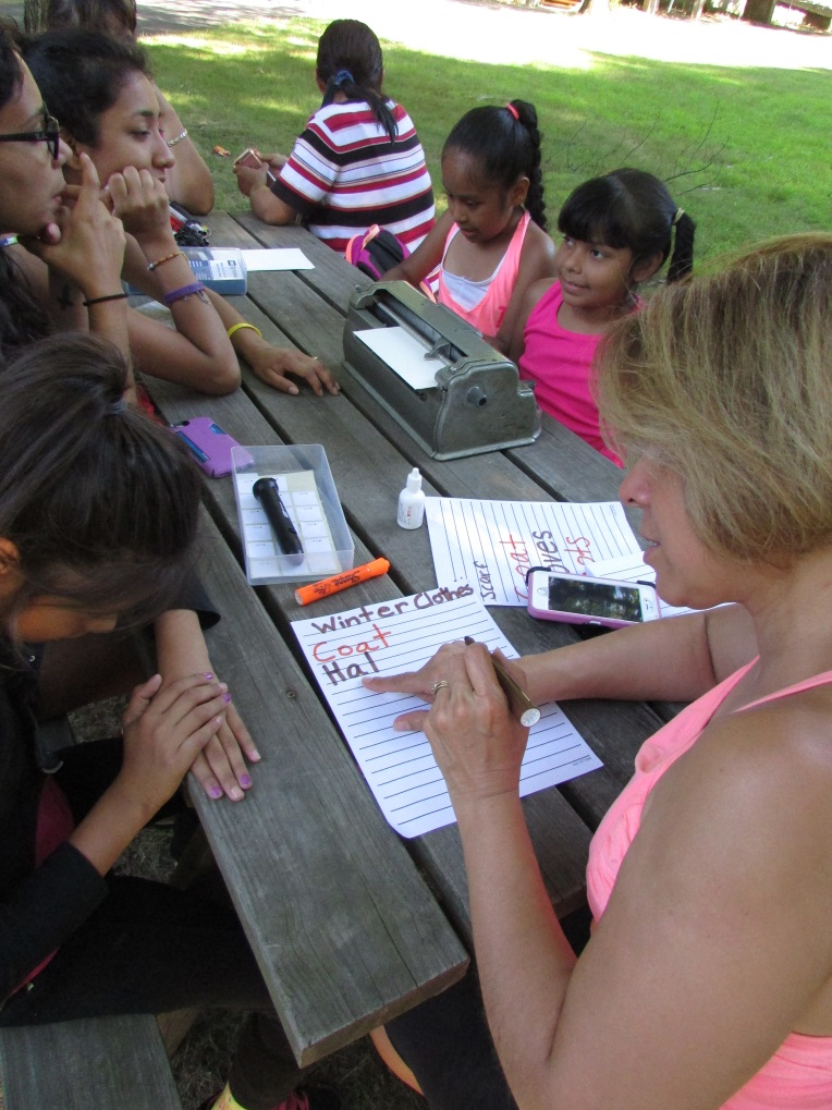 group writing on picnic table