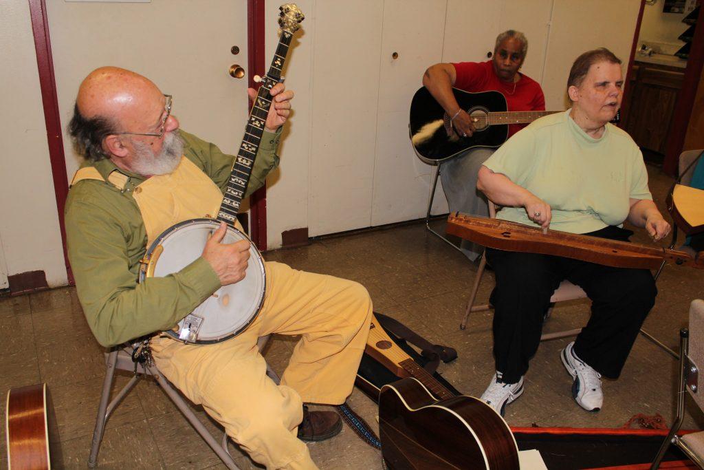Old man playing a banjo