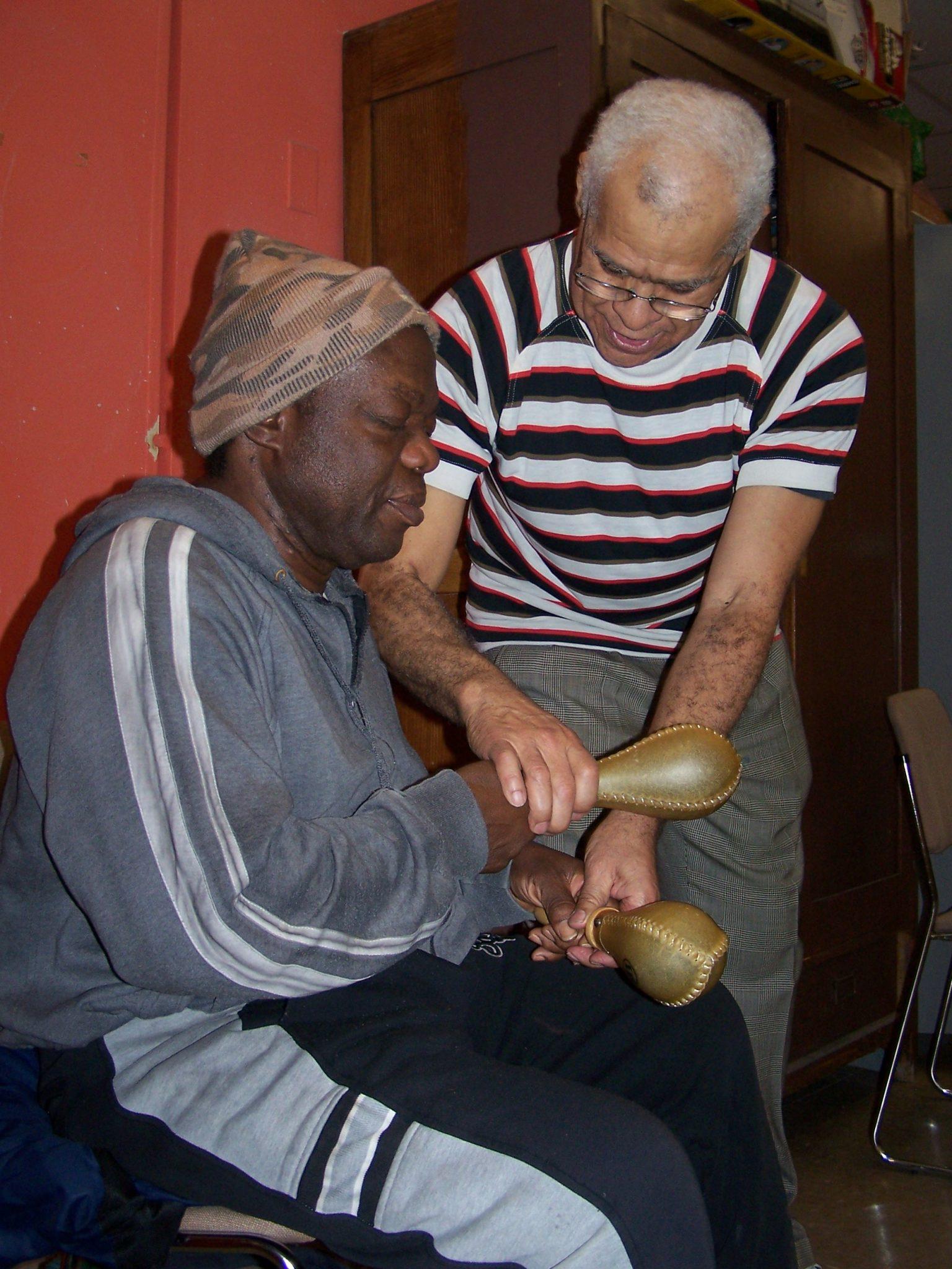 teaching a man how to hold marachas