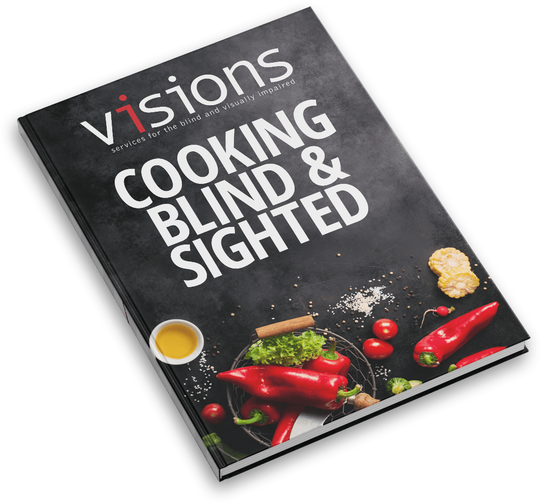 "Graphic: A realistic mockup of a hardcover book. The cover shows assorted vegetables on a black cooking surface, with text at the top reading ""Cooking Blind and Sighted"""