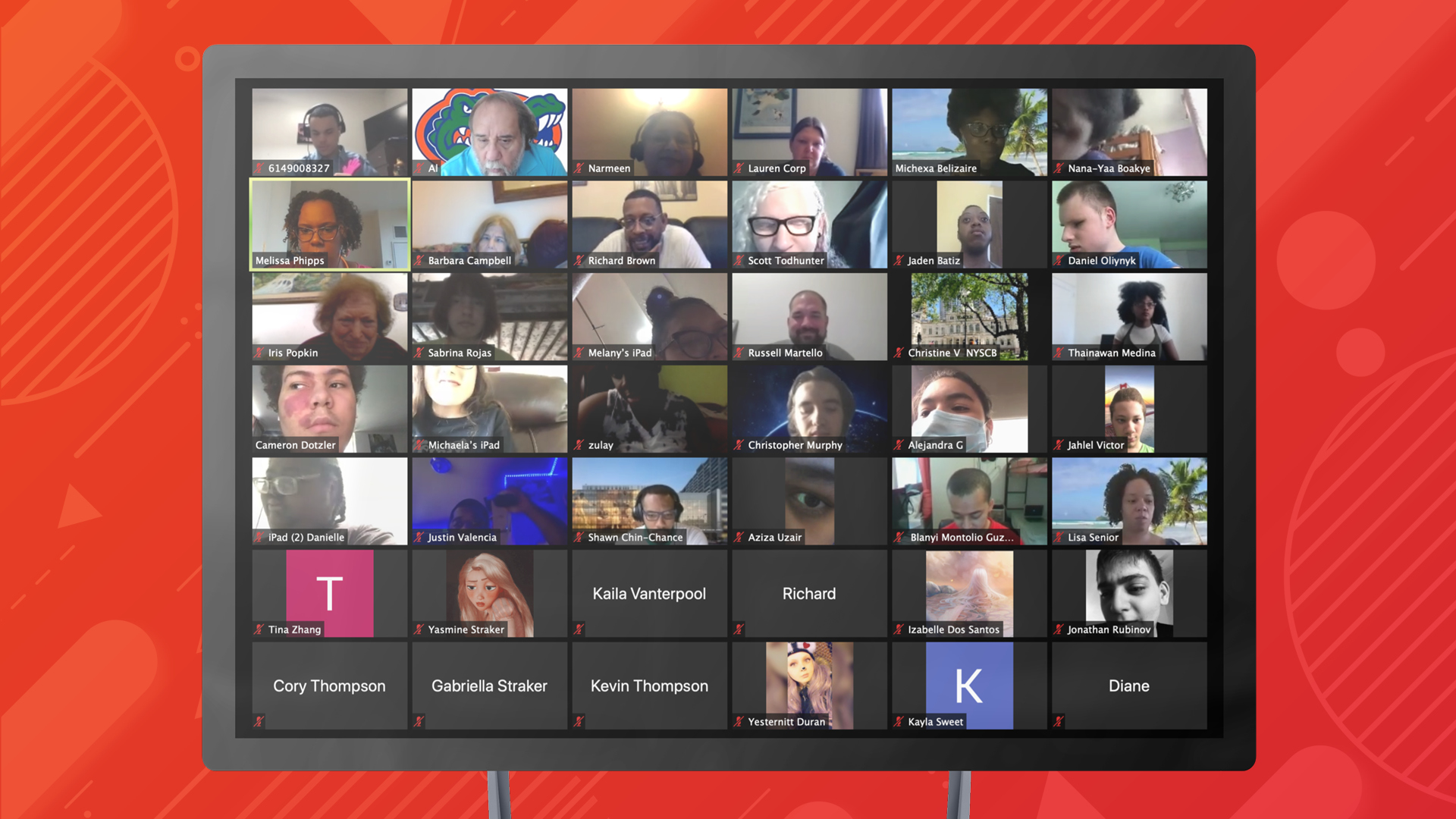 A large computer monitor shows a massive Zoom conference with over 42 participants.