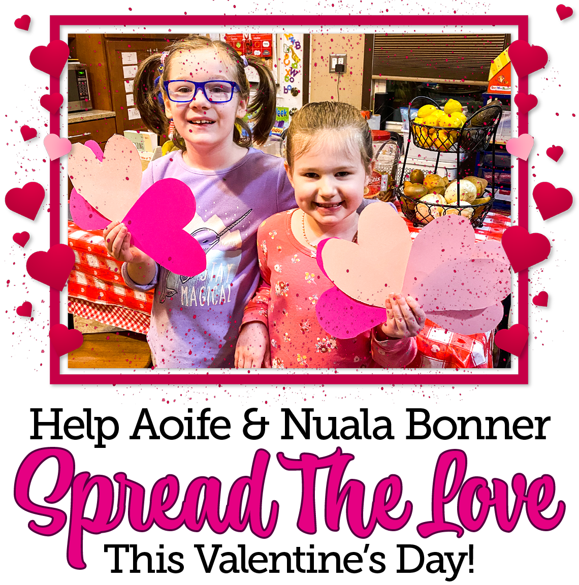 Aoife and Nuala smile to the camera as they hold up paper hearts. Text beneath reads :Help Aoife and Nuala Bonner spread the love this Valentine's Day!""