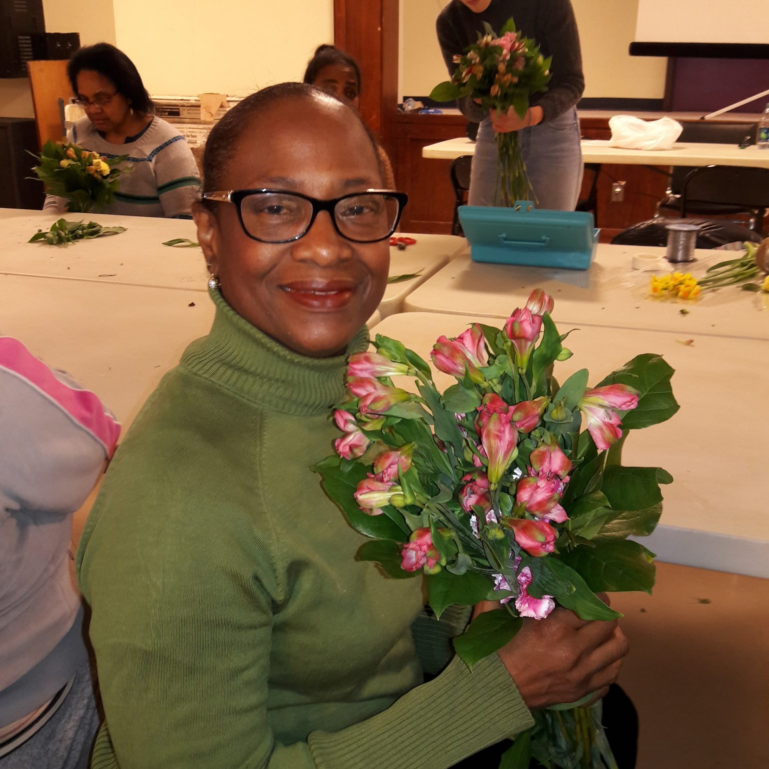 Senior Center - Bernandine G flower workshop - creating a beautiful bouquet of pink carnations